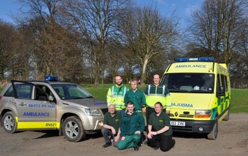 Some of our staff with two of our vehicles