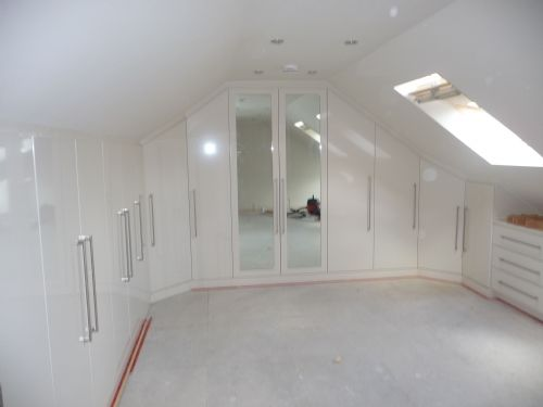 Bespoke fitted dressing roomin a cream gloss finish in loft conversion