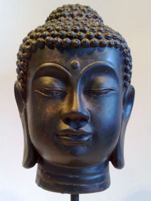 Black Buddhas Head On Stand