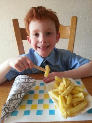 One of my happy little customers eating his fish n chip cone
