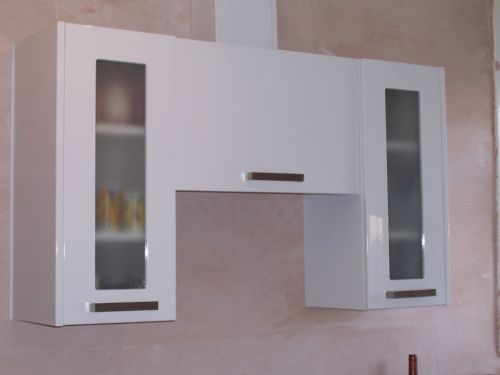 Kitchen - high gloss white units.