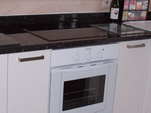 Intergrated cooker and glass hob.