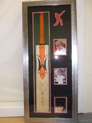 Cricket bat and photos framed.