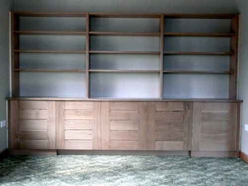 Oak bookcase over 2 cupboards & rad cover