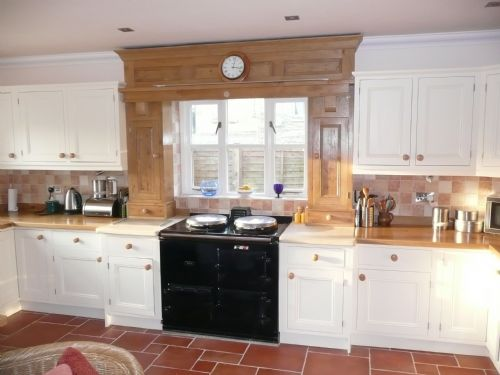 oak arch (including cupboards and drawers) above the Aga
