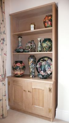 Oak display cabinet made free standing to fit in an alcove.