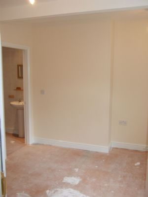 A tastefully refurbished room before carpets were fitted