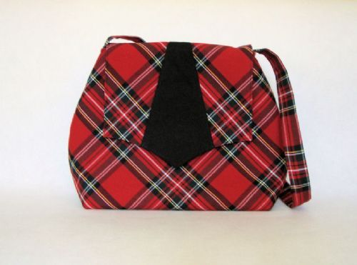 This bag is perfect for everyday use. It is made with a red tartan mixed fabric. It is fully lined with red cotton. The black appliqué on the flap is made with black cotton. The bag is fully padded to give extra strength.