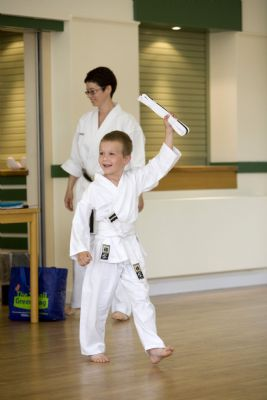 Happy student with new belt after passing his examination