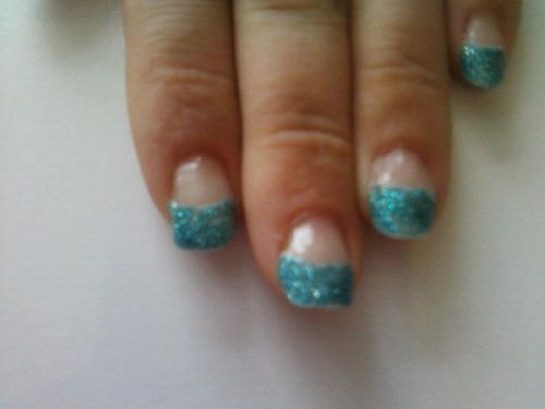 Blue glitter acrylic tips excellent for a prom or girls night out.