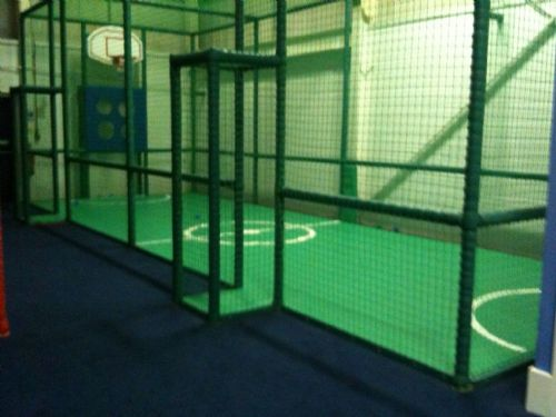 Mini football/basketball pitch.