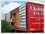 T. Barron Van with storage containers loading