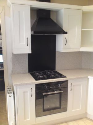 Showroom display white painted platinum finish with baumatic appliances black steel.