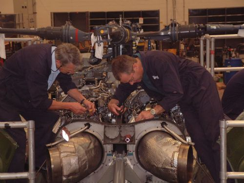 Engine fitters work on a Lynx helicopter
