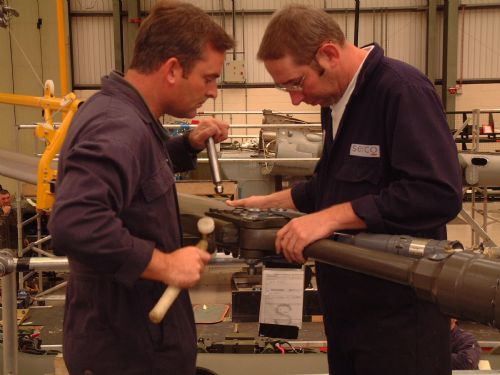 Fitting the blade retaining pins to a Lynx helicopter rotor blade
