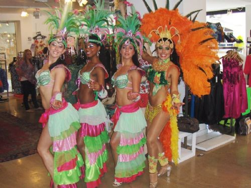 Salsa dancers at the Resurrection shop during the Carnival