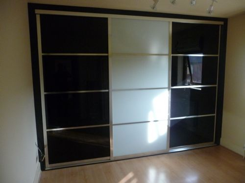 Bespoke black and white glass japanese style sliding wardrobe doors