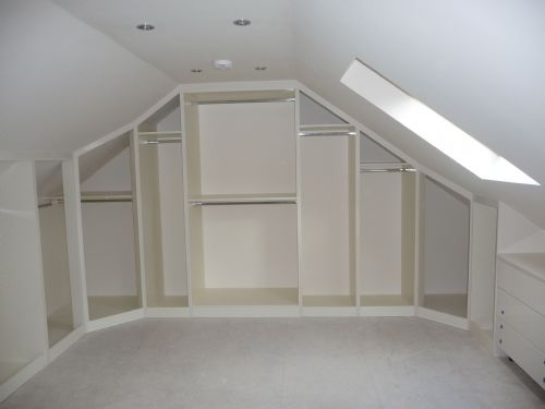 Bespoke sloped doors in loft conversion (interior view) before doors are fitted