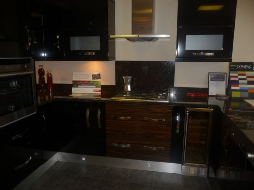 Black gloss kitchen with granite worktops and NEFF appliances