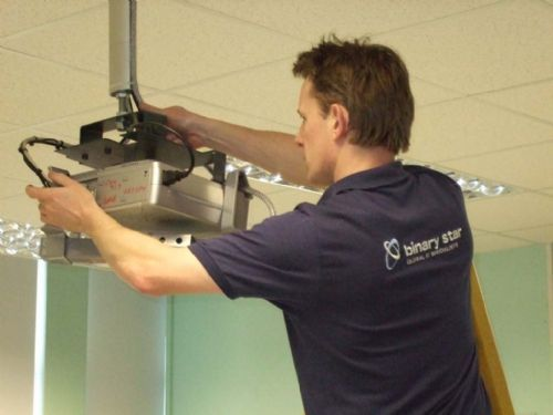 One of our CRB checked Installation team installing a projector into a Local School