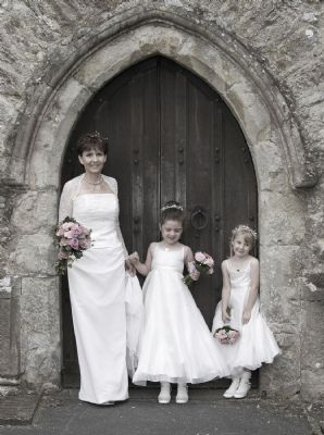 Wedding shot of bride and bridesmaids with retro 'look'.