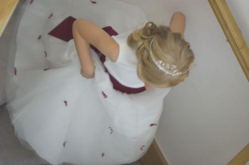 Bridesmaid: candid shot as she runs down stairs.