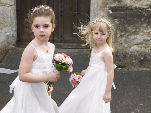 Bridesmaids as they turn towards the oncoming bride.