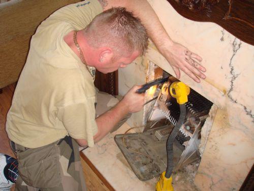 De-commissioning a old fire back boiler.