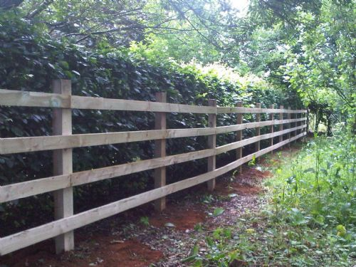 Standard post and rail fencing erected recently.