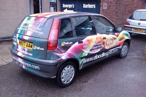 Doodle Signs company vehicle wrap