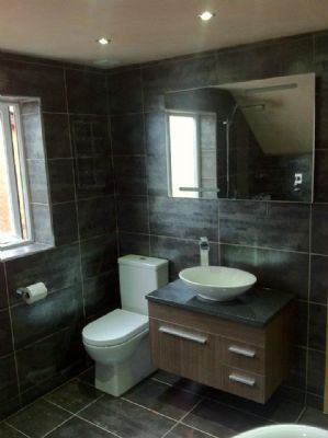 fully tiled wet-room bathroom