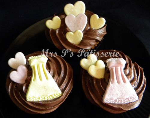 Chocolate cupcakes with dresses and hearts decorations