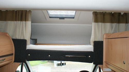 Interior view of the double bed over the cab