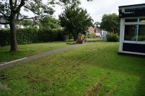 School in West Sussex. Large area of boggy grass. Children not able to use for 6 months of the year. Job: Widen tarmac pathway to take lorry. Install hard wearing grass for active area.