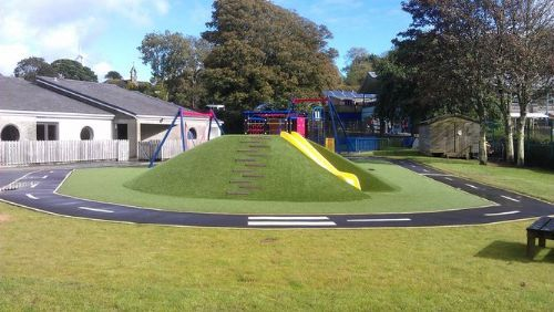 Client: School. Area to be grassed: All weather play mound with slide, swings, race track.
