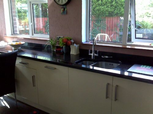 High gloss cream kitchen with granite worktops