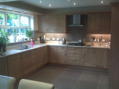 Solid oak shaker kitchen with Zodiaq composite stone worktops