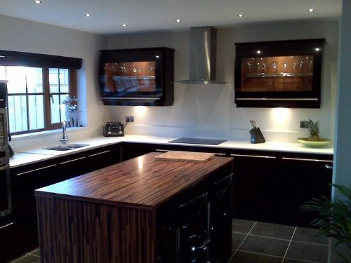 High gloss black kitchen with Zodiaq composite stone worktops and walnut island