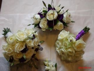 wedding flowers of hand tied bouquets and matching basket