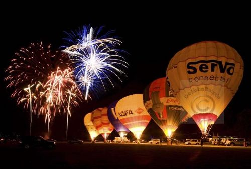 Balloon burners and fireworks light up the night sky in Essex. (magazine feature)