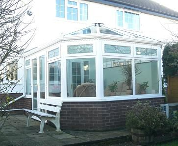 White UPVC Conservatory with beveles, seflf cleaning glass roof and air conditioning unit