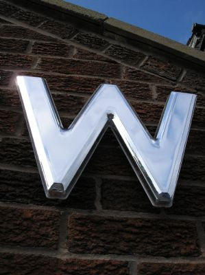 Close up of silver moulded letter