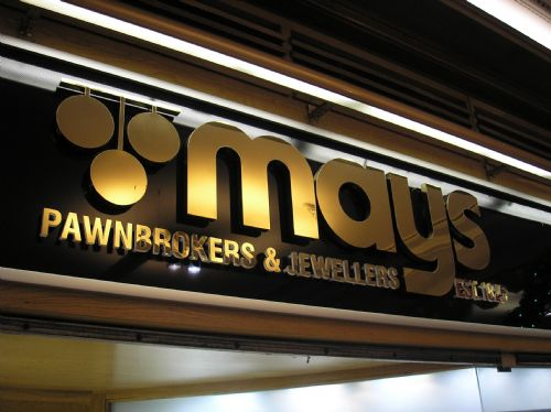 Polished gold stainless steel letters on a dibond panel