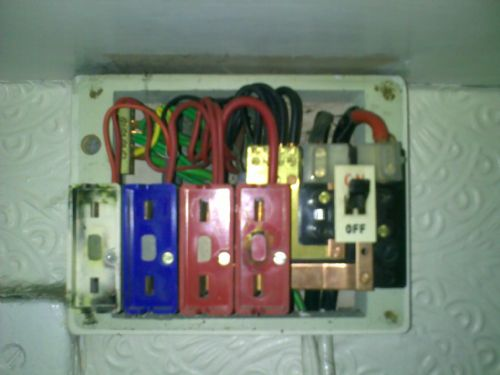 A typical old catridge type fuse board which we then upgraded.