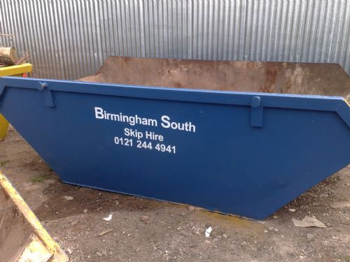 A large Builders Skip- with door for ease of loading