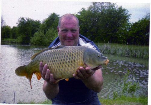Mick with a 12.5lb carp - Swears by Warburtons!!!!