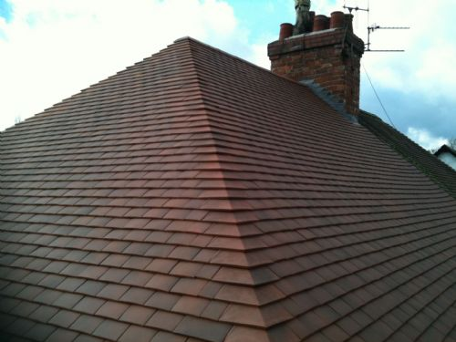 Clay tuscan humber tile with arris hips