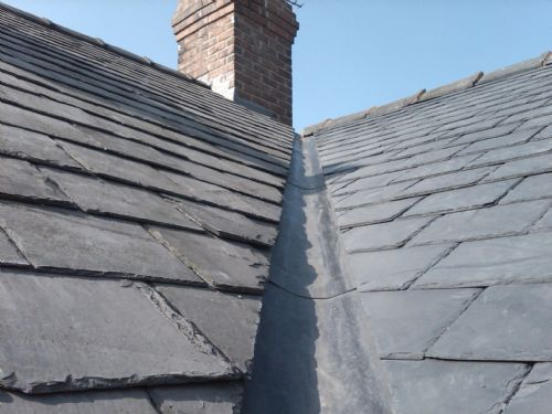Code 4 lead valley, existing slates relaid to the l/h/s, new la roca slates laid to the r/h/s