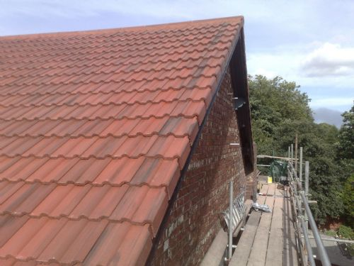 New Sandtoft Rustic Double Roman roof tiles with cloaked verge tiles and segmental ridges.