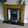 oak surround with cast iron inset fitted in Glasgow